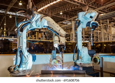 Industrial robots are welding in automotive industrial factory