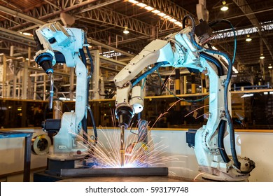 Industrial robots are welding automotive part in car factory