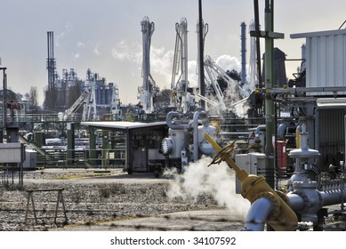 Industrial scene - Back lit oil & chemical gas production plant
