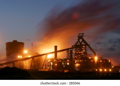 Industrial scene at night. Smog contributing to climate change