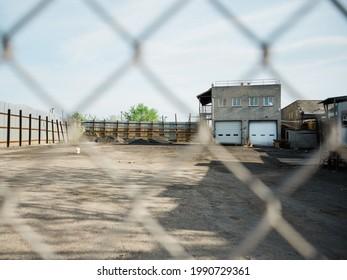 Industrial scene seen through a fence, in East Williamsburg, Brooklyn, New York City