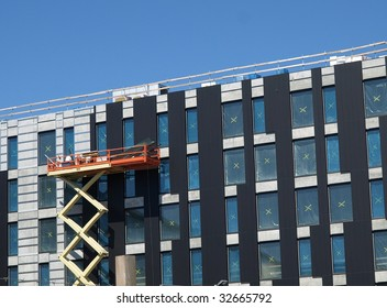 industrial scissor lift in use for building construction