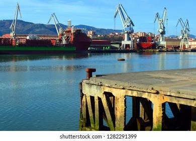 Industrial sea cranes at port landscape