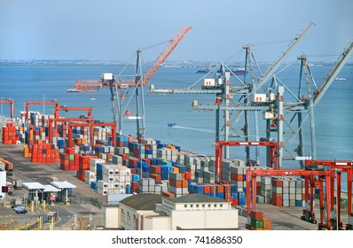 Industrial sea port with containers and cranes.