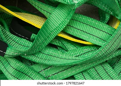 Industrial sewing machine sews a webbing sling. Manufacture of textile slings and tie straps
