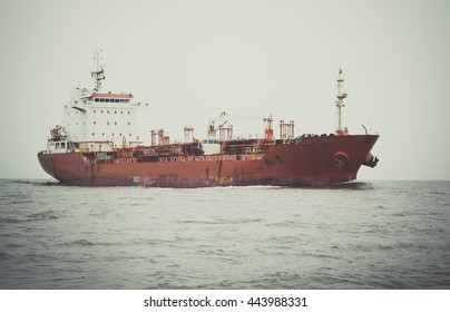 Industrial ship ,  commercial cargo ship carrying containers,retro tone
