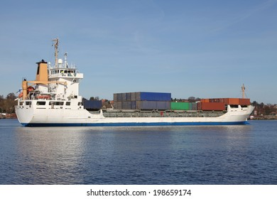 industrial ship with containers on Kiel Canal