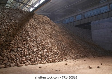 Industrial shop filled with stone ore.