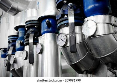 Industrial shot with a manometers and heating pipelines inside a water heating station