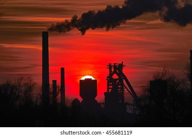 industrial silhouettes: steel factory in red sunset / sundown, Stahlwerke Bremen, Germany
