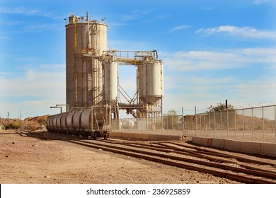 Industrial Silo and Boxcar train wagons in Desert