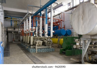 Industrial size generators in a factory machinery room
