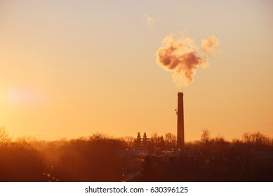 Industrial smoke from chimney over the town