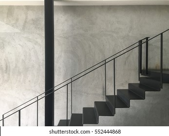 Industrial Staircase in Black Paint Finish with Concrete Wall Background