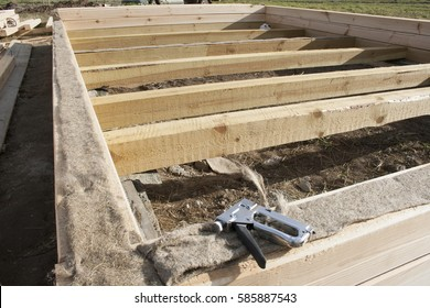 Industrial stapler lies on the foundation of the house under construction