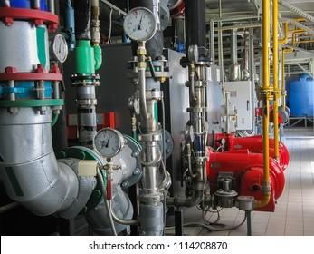 Industrial steam boilers in the boiler room, and powerful turbine gas burner