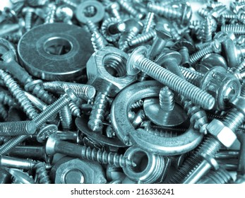 Industrial steel hardware bolts, nuts, screws useful as background - cool cyanotype