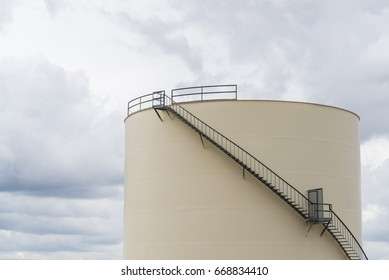industrial storage tank for oil or water with stairs. manufacturing power and energy or environmental concepts.
