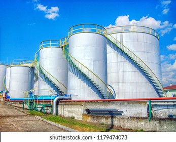 Industrial storage tanks and fire lines. Appearance of an oil and chemical storage facility.