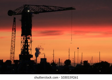 Industrial structures and sunset.
