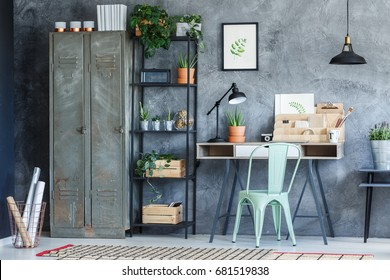 Industrial study room with metal wardrobe, rack and desk