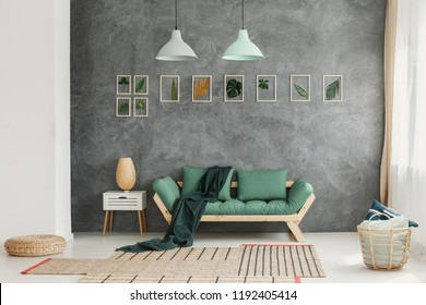 Industrial style ceiling lights and scandinavian wooden furniture in a modern living room interior with natural materials