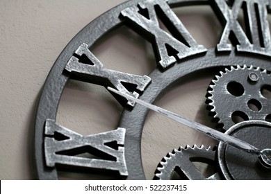Industrial style wall clock with roman numbers on ten.