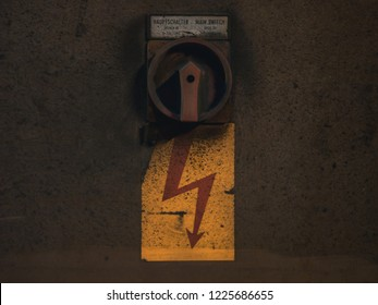"""Industrial switch with red flash on yellow ground, text saying """"main switch, open in off position"""""""