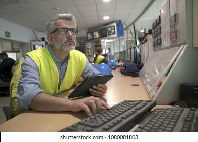 Industrial technician in control room
