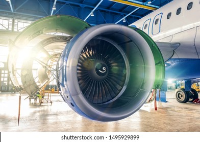 Industrial theme - repair and maintenance of aircraft jet engine on the wing of the airplane