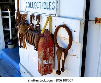 Industrial Tools, Fishing Industry Sea Captain's Tools Hanging on Dockside Door, Close Up, Sport Fishing or Fishing Industry Concept, Vintage