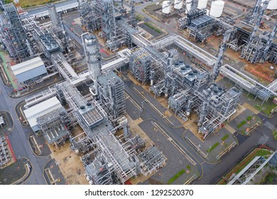 Industrial top view at oil refinery plant form industry zone ,which factory - petrochemical plant, Shot from drone of Oil refinery.evening scenery.