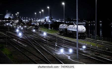 Industrial train yard at night