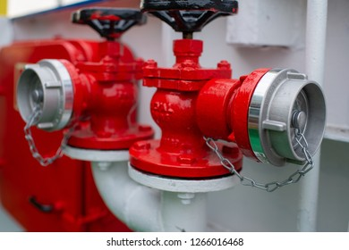 Industrial transfer of the red fire hydrant. Water fire extinguishing system. Fire safety. Manual gate valve on the fire hydrant.