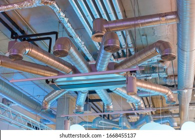 Industrial ventilation system ducts and pipes and electrical communications under ceiling