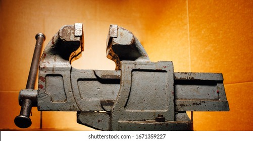 industrial vice tool, orange background
