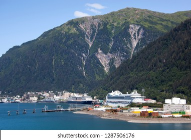 The industrial view of Juneau town port with a downtown in a background (Alaska).
