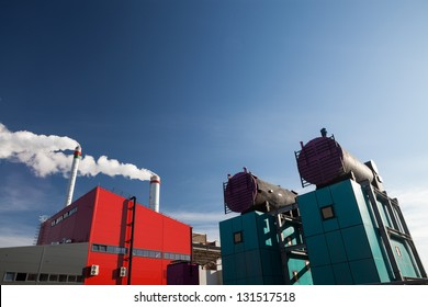 Industrial view of modern biomass power plant  while construction process on the blue sky background