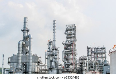 Industrial view at oil refinery plant form industry zone with sunrise and cloudy sky