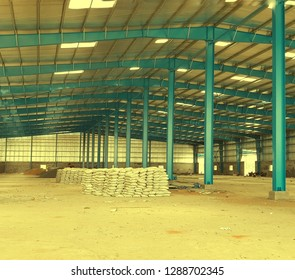 industrial warehouse ceiling light yellow panel blubs concept background.