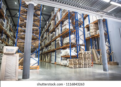 Industrial warehouse and logistics concept. Large storage with racks, shelves, boxes, containers and other goods. Interior with perspective, toned