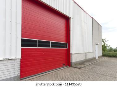 industrial warehouse with red roller door