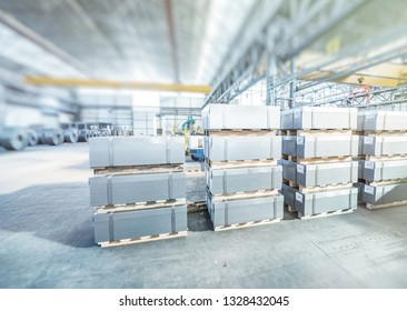 Industrial warehouse with shelves and loaders. Bottom view, metal colis.