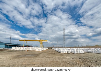 Industrial warehouse for the storage of bulk technological materials. Lots of big bags. Open storage warehouse. The storage is equipped with a lightning protection system.