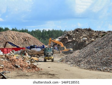Industrial waste treatment processing plant. Landfill with industrial waste. Construction waste process, concrete recycling, crushing and recycling of construction mixed waste and demolition material