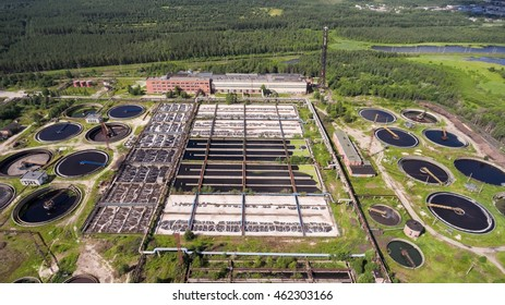 An industrial wastewater treatment plant located in evergreen forest and lakes