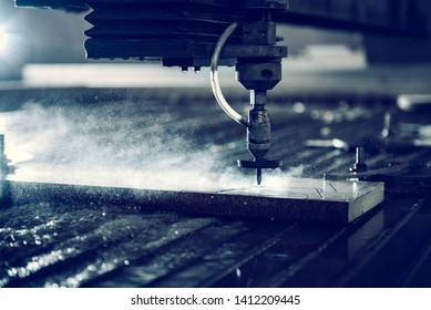 Industrial water jet cutter tool cutting steel plate