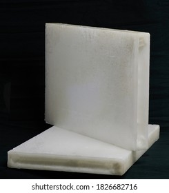 Industrial wax slab white color isolated on black background