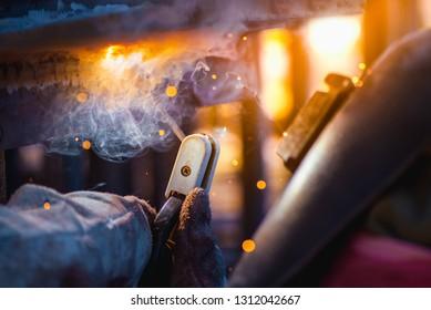 Industrial welder welding fabricated construction in factory, Welding process by Shielded Metal Arc Welding (SMAW) or Stick Welding. 6G, PE