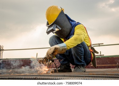 Industrial welder welding fabricated construction in factory Welding process by Shielded Metal Arc Welding (SMAW) or Stick Welding